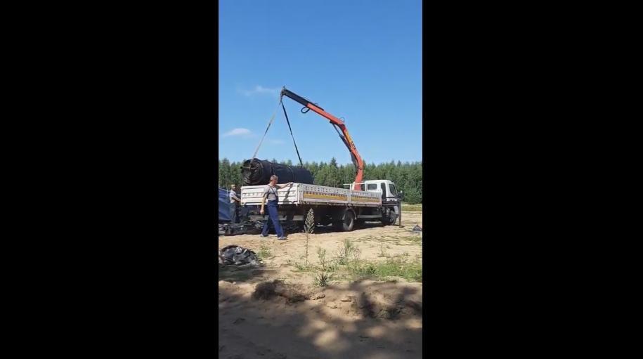 Работа манипулятора, перевозка геотуб